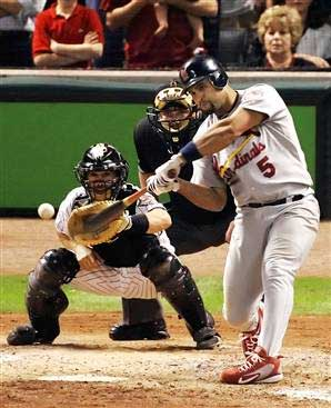 Albert Pujols hitting an outside pitch. Notice the eyes, hands, and feet. Awesome!!!